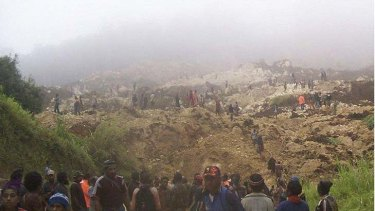 Destruction ... villagers search the site of the disaster, which is reported to have killed at least 40 people.