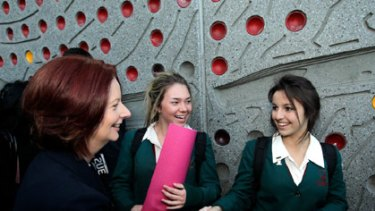 Julia Gillard chats with schoolgirls in Parramatta in western Sydney this morning.