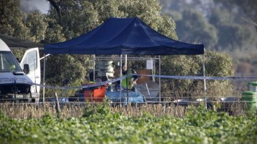 Police continue the search on a property near Hay for the remains of Donald Mackay.