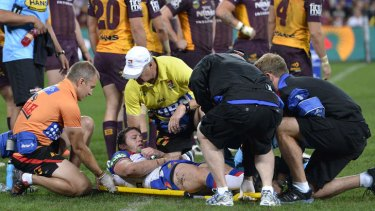Captain down: Kurt Gidley is stretchered off.