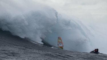 Chased by a monster.  Alastair McLeod rides the Eddystone Rock/Pedra Branca wave
