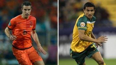 Netherlands forward Robin van Persie and  Australia's striker Tim Cahill.