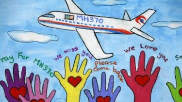 Viewing gallery in Kuala Lumpur: An artwork conveying well-wishes for the passengers and crew of missing Malaysia Airlines Flight MH370.