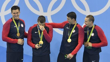 The US team receives its gold medals.