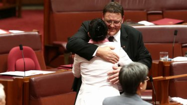 PUP Senator Glenn Lazarus is embraced by PUP Senator Jacqui Lambie after delivering his first speech. Photo: Alex Ellinghausen