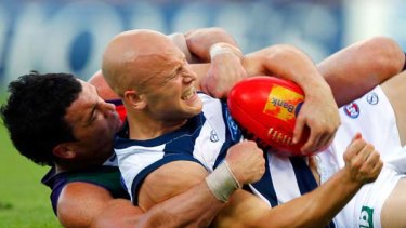 Cat star Gary Ablett is collared in a tackle by Docker Ryan Crowley during Fremantle's thrilling win at Subiaco Oval yesterday.