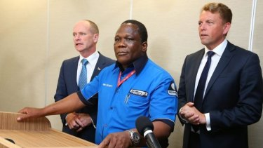 Josphat Mkhawananzi with Premier Campbell Newman and Transport Minister Scott Emerson.