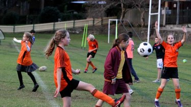 Where do the children play … football training gets under way at Birchgrove Oval. Competition for sporting fields is becoming fierce as the number of players rises.