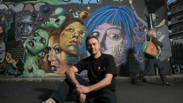 """""""This is really positive. It could be achieved elsewhere with someone with a good heart, who could work with kids."""" ... Tugi Balog and some of the graffiti panels near his shop."""