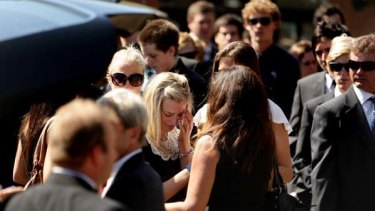 Arielle Bird, centre, the sister of Saxon Bird at his funeral at St Patrick's College in Strathfield.