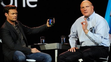 Ryan Seacrest holds the new Nokia Lumia 900 Windows Phone during the keynote address.