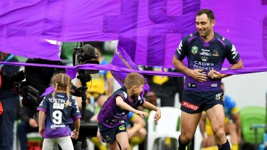 Storm's Cameron Smith runs out with his children for his 356th game.
