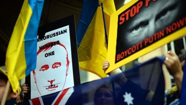 Outrage: Members of the Australian Ukrainian community protest against Putin coming to Australia for the G20 summit.