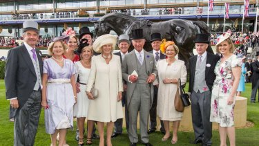 Royals at Royal Ascot ... Black Caviar's owners meet Prince Charles and Camilla as Yeats's statue looks on.