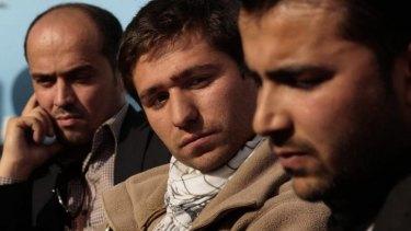 Awaiting visas: Shafiq Nazari, 38, from left, Shirullah Mirzamik, 23, and Sardar Khan, 26,
