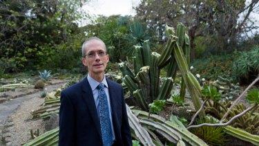 Professor Tim Entwisle in the vandalised Arid Garden.
