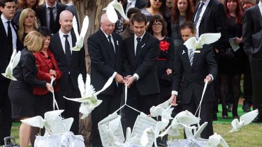 The way they remember her best: Doves and tears released at murder victim Jill Meagher's funeral at Fawkner Cemetery yesterday.