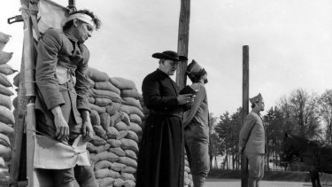 The prisoners are prepared for execution in Stanley Kubrick's film <i>Paths of Glory</i>.