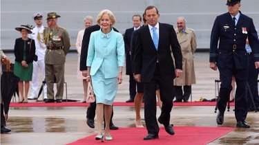 Outgoing Governor-General Dame Quentin Bryce, pictured with the Prime Minister as she departured Canberra on Wednesday, has been made a dame as part of Tony Abbott's reintroduction of imperial honours.