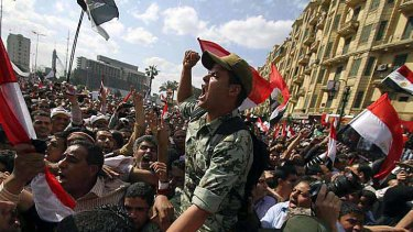 An Egyptian army officer is carried on demonstrators' shoulders.