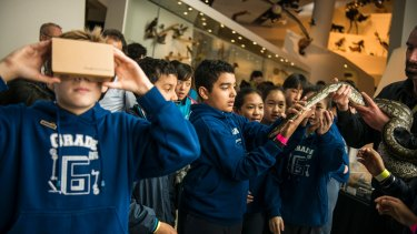 MELBOURNE, AUSTRALIA - SEPTEMBER 14: Students from Carlton Gardens Primary School are seen embarking on the first Natural History Google Expedition using Google Cardboard at Museum Victoria on September 14, 2016 in Melbourne, Australia. (Photo by Josh Robenstone/Fairfax Media) Museum Victoria is partnering with Google on the launch of their new Natural History platform.
