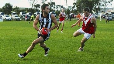 Star in stripes: Former Carlton forward Brad Fisher on the run for Dalyston.