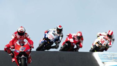 Catch me if you can ... Casey Stoner winds up his Ducati as his chasers play catch-up during the Australian MotoGP at Phillip Island yesterday. Stoner went on to claim his fourth straight win in the race.