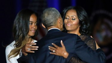 President Barack Obama with wife Michelle and daughter Malia after his presidential farewell address.