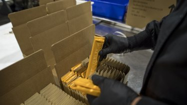 An employee packs Kiva Confections cannabis-infused chocolate into boxes at the company's headquarters in Oakland, California.