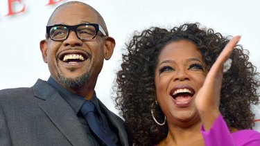 """The incident in Switzerland was just an incident"": Oprah Winfrey with actor Forest Whitaker at the opening of The Butler, apologises  over ""racism"" incident."