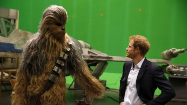 When Harry met Chewie ... Britain's Prince Harry gets some acting tips from Chewbacca during a tour of the Star Wars sets at Pinewood studios in Iver Heath, west London on April 19.