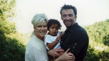 """It's a big deal to take on an older child who's been traumatised"" ... Deborra-Lee Furness with her husband Hugh Jackman and their son Oscar."