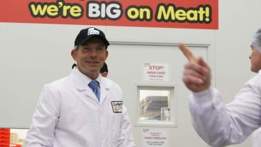 Opposition Leader Tony Abbott visited a meat factory in Sydney to discuss his policy of repealing the carbon tax and skilled migration.