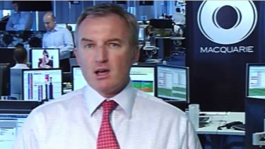 Stockbroker David Kiely was sprung looking at near naked pictures of Miranda Kerr while colleague Martin Lakos did a live cross on Channel Seven.