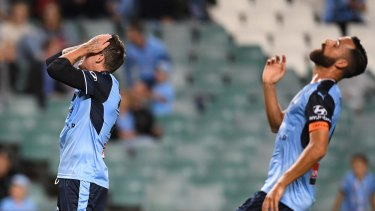 So close: Alex Brosque, right, reacts to a missed goal.
