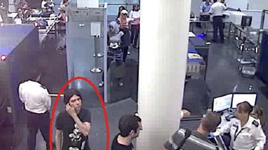 Is it him? ... This surveillance image provided by Interpol shows who authorities believe is Luka Rocco Magnotta at a security checkpoint area.