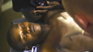 Wismond Exantus,  rescued by a French search and rescue team after being trapped in rubble for 11 days in the aftermath of the massive earthquake, lies in a French military hospital in Port-au-Prince, Haiti.