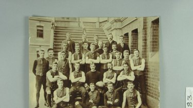 Melbourne Football Club team photo, 1900. A Demons jumper,  worn in the 1900 Grand Final by Austin ''Goosey'' Lewis, is expected to fetch more than $10,000 at auction.