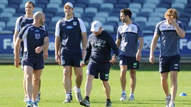 Geelong's Trent West, Paul Chapman, Tom Hawkins, and Jimmy Bartel leave the ground after training.