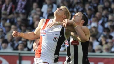 Nathan Brown tries to come with grips with  Nick Riewoldt.