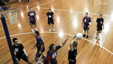 Going for goal ... men's teams play netball during a competition night at Lidcombe.