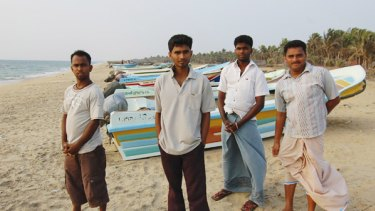 Standing near the point where people-smugglers' boats leave from Andimunai, S. Prabhu (left), Arun Raj, Kethwes Kumar and Kether Vran all say they want to try to come to Australia by boat.
