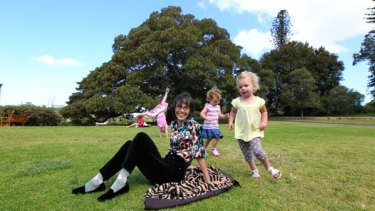 Freedom before fear ... children frolic while Lenore Skenazy kicks back in the Sydney Botanical Gardens.