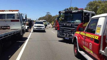 Two people freed in Tonkin Highway smash