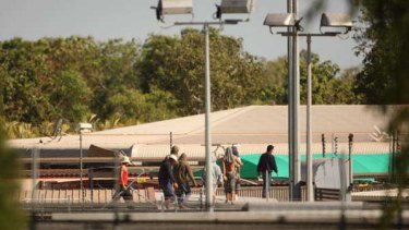 More than 100 detainees protest for a second day on the roof of Darwin's immigration detention centre.