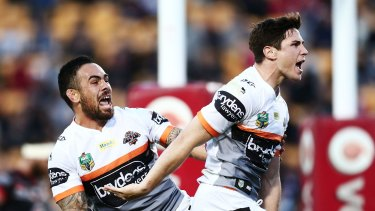 Much improved: Mitchell Moses celebrates with teammate Dene Halatau after scoring a try during the round 25 NRL match between the New Zealand Warriors and the Wests Tigers at Mount Smart Stadium.