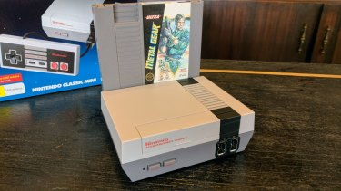 The Mini is around as wide as one original NES cartridge. Sadly, <i>Metal Gear</i> is not included.