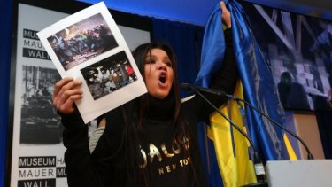 Ruslana the activist singing the Ukrainian national anthem in Berlin in February.