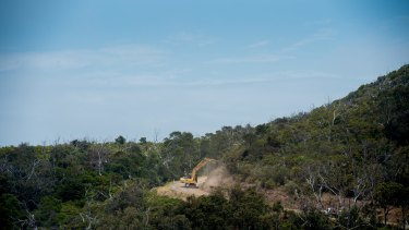 Earth-moving equipment working in Kennett River. A firefighting crew from New Zealand are expected to arrive at the fire ground on Monday.