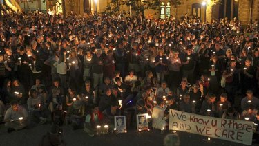 Crying out for change: Hundreds take part in the candlelight vigil at Sydney's Town Hall.